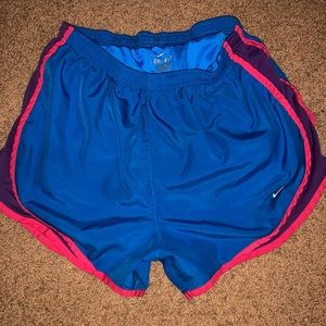 BLUE NIKE SHORTS with pink and purple Stripe